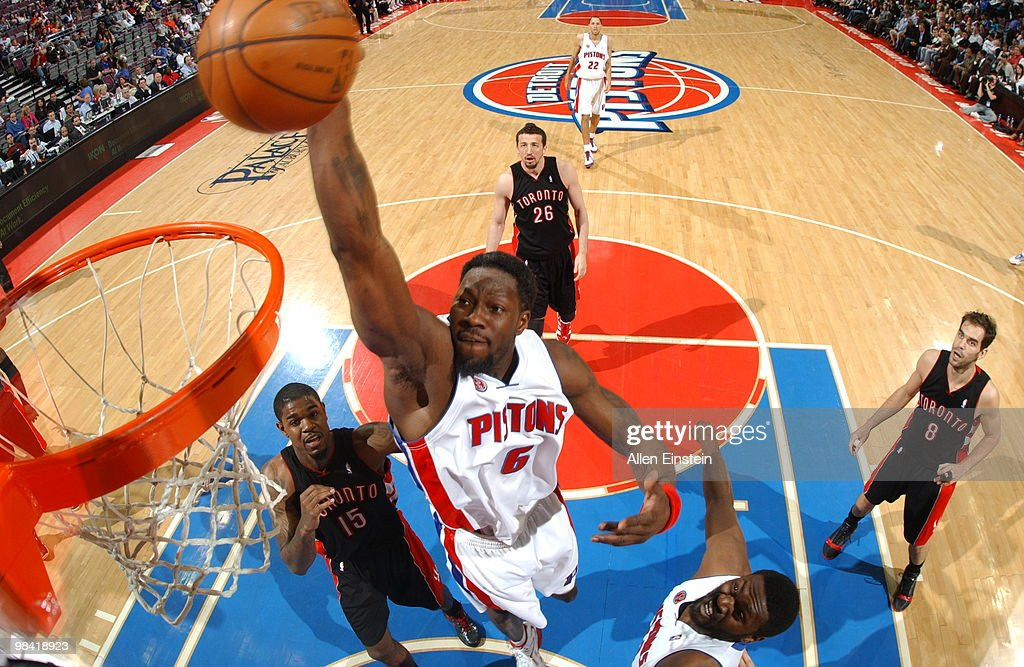 Ben Wallace of the Detroit Pistons goes up for a dunk over Amir Johnson of the Toronto Raptors in a game at the Palace of Auburn Hills on April 12...