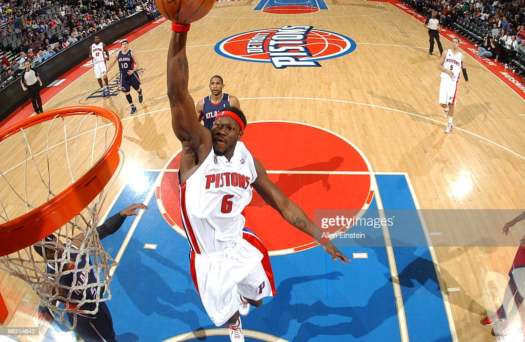 Ben Wallace of the Detroit Pistons goes up for a dunk past Josh Smith of the Atlanta Hawks in a game at the Palace of Auburn Hills on April 7 2010 in...