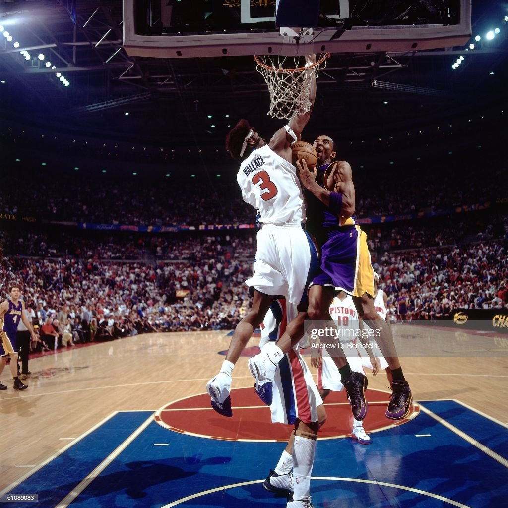 Ben Wallace #3 of the Detroit Pistons goes up to block a shot attempt by Kobe Bryant #8 of the Los Angeles Lakers during Game Five of the 2004 NBA Finals on June 15, 2004 at The Palace of Auburn Hills in Auburn Hills, Michigan.