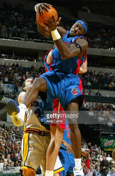 Ben Wallace of the Detroit Pistons grabs a rebound against the Indiana Pacers on December19 2003 at Conseco Fieldhouse in Indianapolis Indiana NOTE...