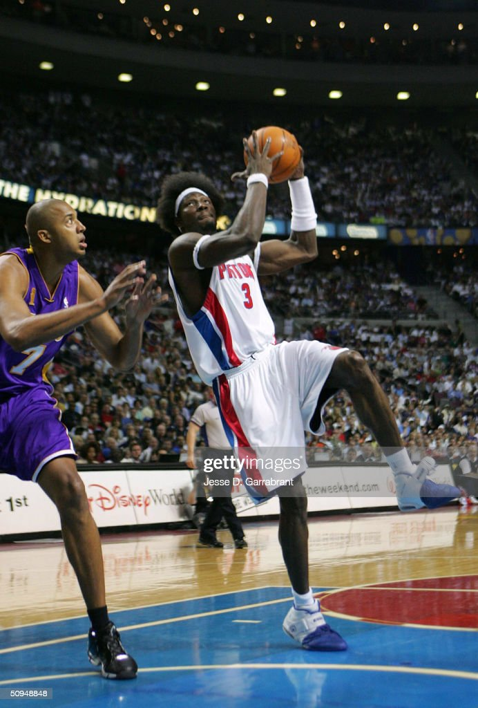 Ben Wallace #3 of the Detroit Pistons shoots against Brian Cook #7 of the Los Angeles Lakers in Game three of the 2004 NBA Finals on June 10, 2004 at The Palace of Auburn Hills in Auburn Hills, Michigan.