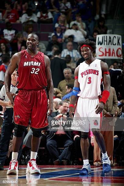 Ben Wallace of the Detroit Pistons stands next to Shaquille O'Neal of the Miami Heat in Game three of the Eastern Conference Finals during the 2005...