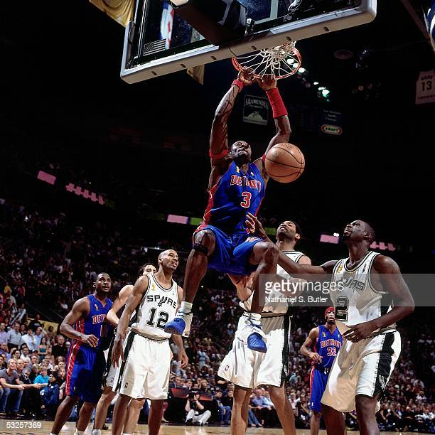 Ben Wallace of the Detroit Pistons throws down a dunk against Nazr Mohammed and Tim Duncan of the San Antonio Spurs in Game Seven of the 2005 NBA...