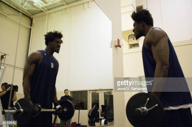 Ben Wallace of the of the Detroit Pistons works out with free weights on March 13 2004 at the Palace of Auburn Hills in Auburn Hills Michigan NOTE TO...