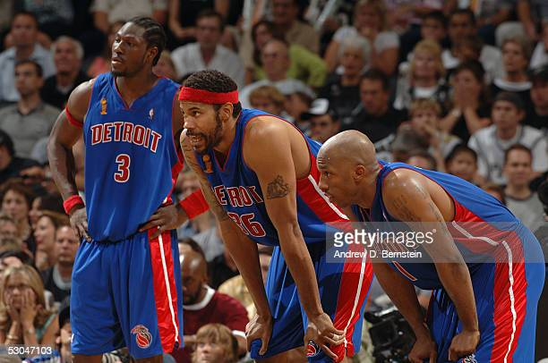 Ben Wallace Rasheed Wallace and Chauncey Billups of the Detroit Pistons take a breather against the San Antonio Spurs in Game One of the 2005 NBA...