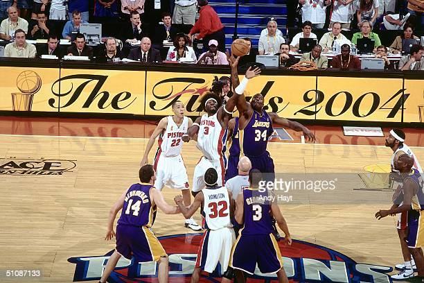 Ben Wallace#3 of the Detroit Pistons tips off against Shaquille O'Neal of the Los Angeles Lakers to start Game Five of the 2004 NBA Finals on June 15...