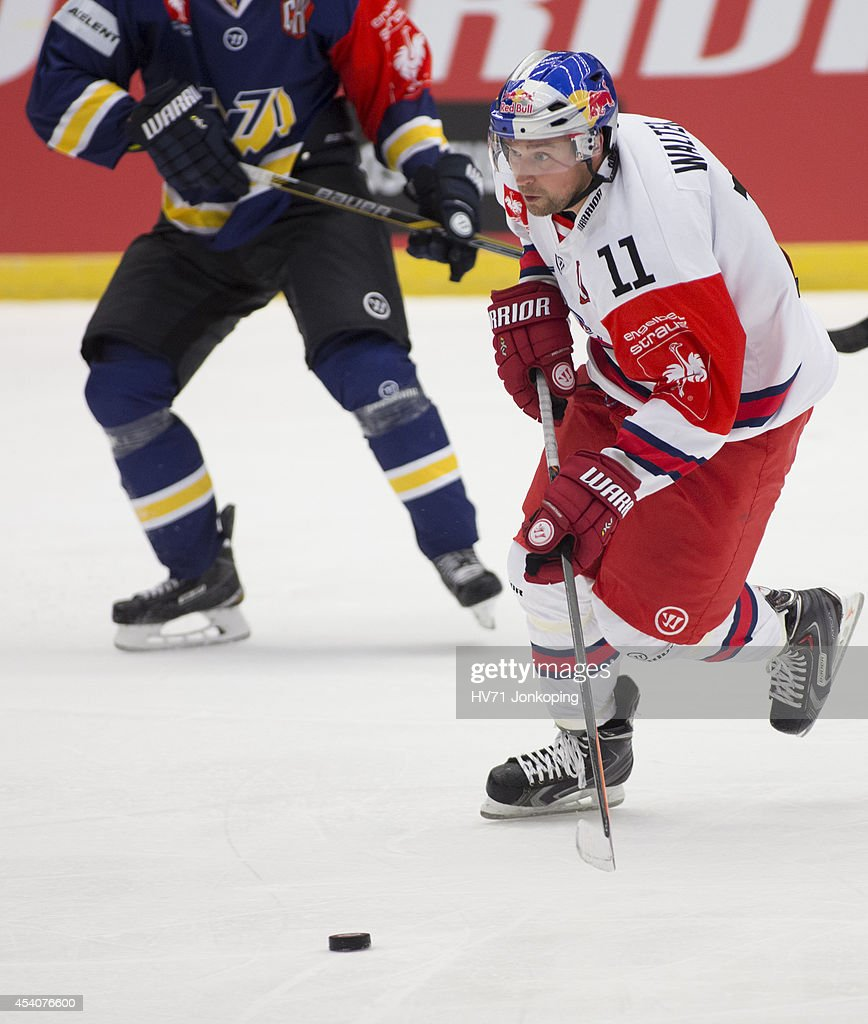 Ben Walter #11 of Red Bull Salzburg in action during the Champions Hockey League group stage game between HV71 Jonkoping and Red Bull Salzburg on August 24, 2014 in Jonkoping, Sweden.