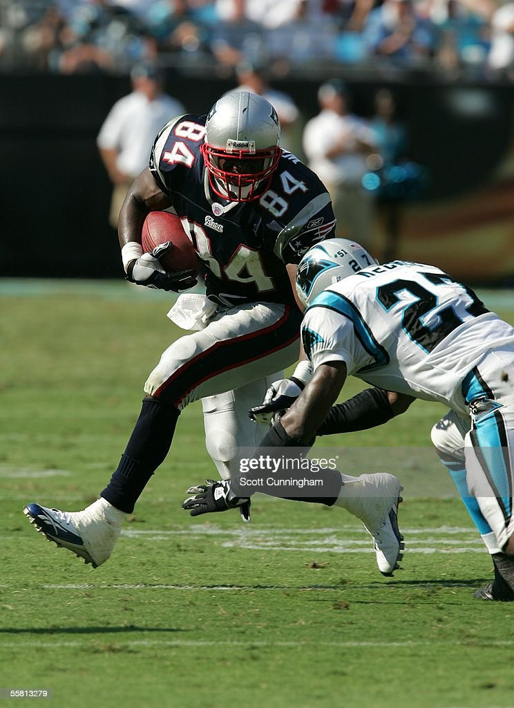 Ben Watson #84 of the New England Patriots runs against Marlon McCree #27 of the Carolina Panthers at Bank of America Stadium on September 18, 2005 in Charlotte, North Carolina. The Panthers defeated the Patriots 27-17.
