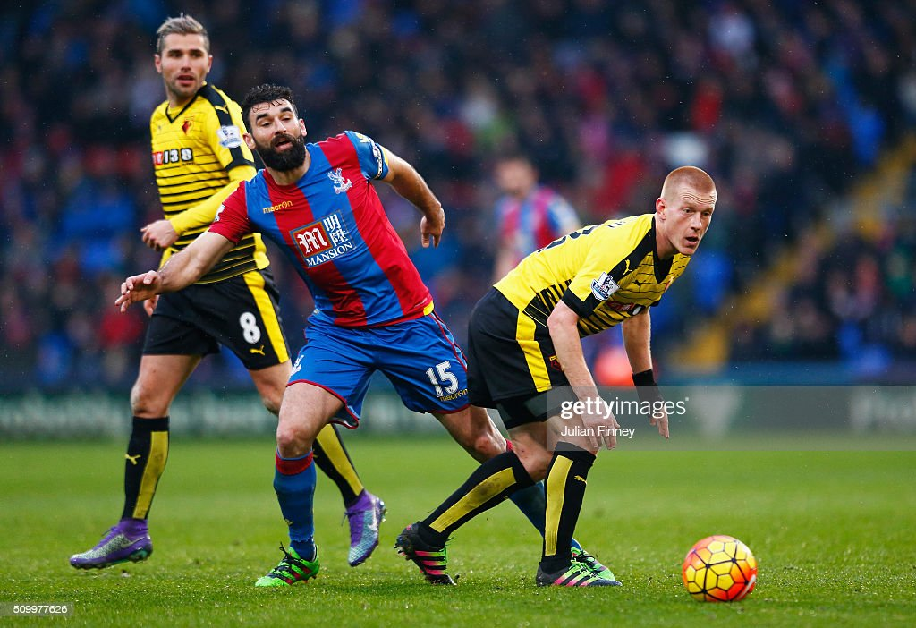 Ben Watson of Watford and Mile Jedinak of Crystal Palace compete for the ball during the Barclays Premier League match between Crystal Palace and Watford at Selhurst Park on February 13, 2016 in London, England.