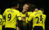 Ben Watson of Watford celebrates with Troy Deeney of Watford and Odion Ighalo of Watford after scoring his side's first goal during the Barclays...