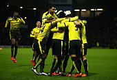 Ben Watson of Watford is mobbed by his team mates after scoring his side's first goal from a corner during the Barclays Premier League match between...