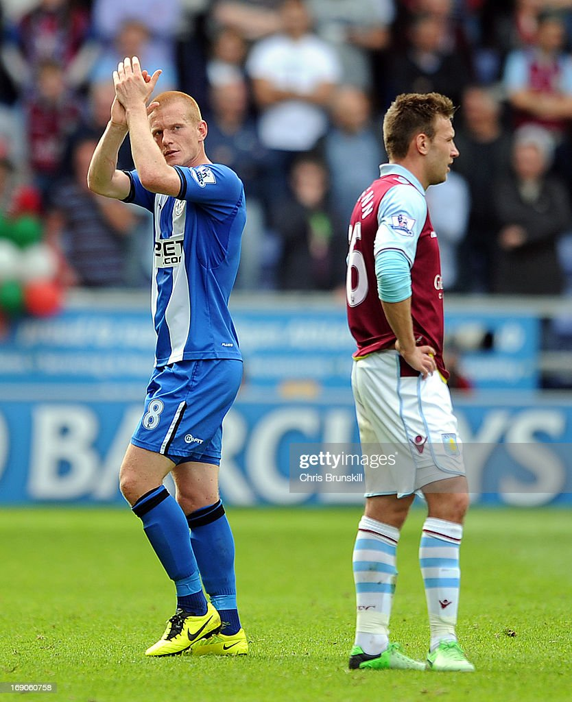 Ben Watson of Wigan Athletic applauds the supporters as he leaves the field after being substituted during the Barclays Premier League match between Wigan Athletic and Aston Villa at DW Stadium on May 19, 2013 in Wigan, England.
