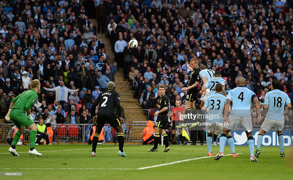 Ben Watson of Wigan Athletic heads in the winning goal during the FA Cup with Budweiser Final match between Manchester City and Wigan Athletic at Wembley Stadium on May 11, 2013 in London, England.