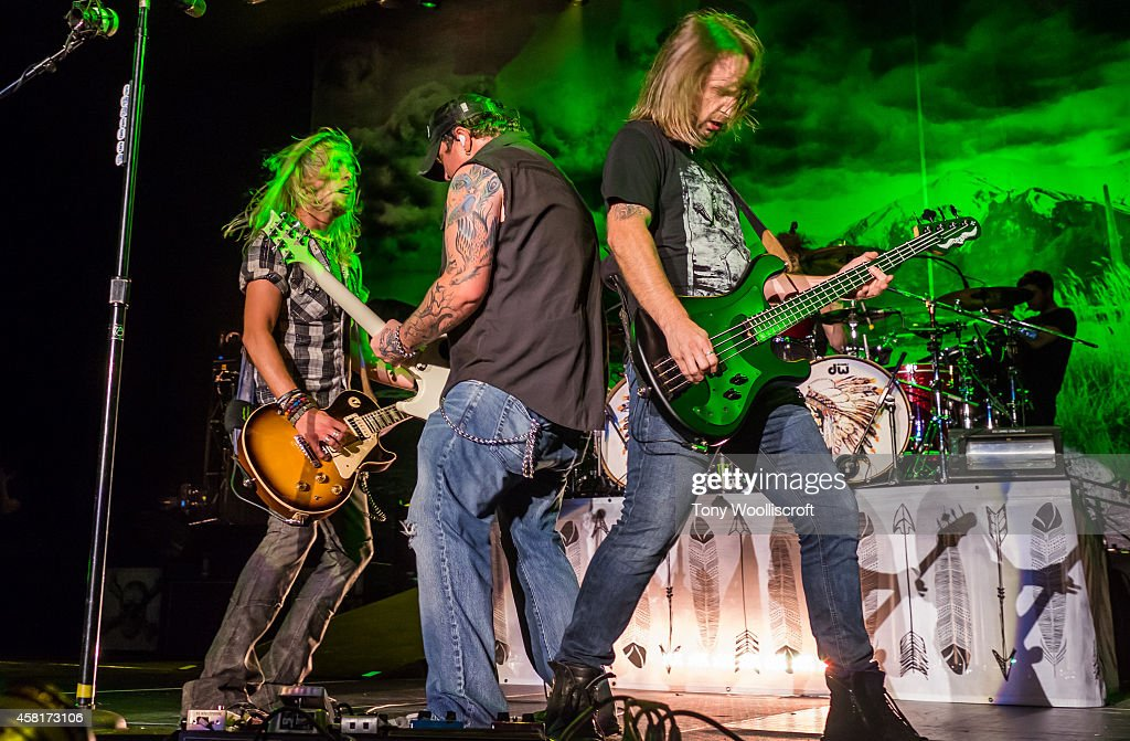 Ben Wells and Chris Robertson and John Lawhon of Black Stone Cherry performs at LG Arena on October 30, 2014 in Birmingham, England.