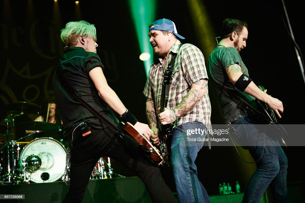 Ben Wells, Chris Robertson and Jon Lawhon of American hard rock group Black Stone Cherry performing live on stage at the Motorpoint Arena in Nottingham, on January 29, 2016.