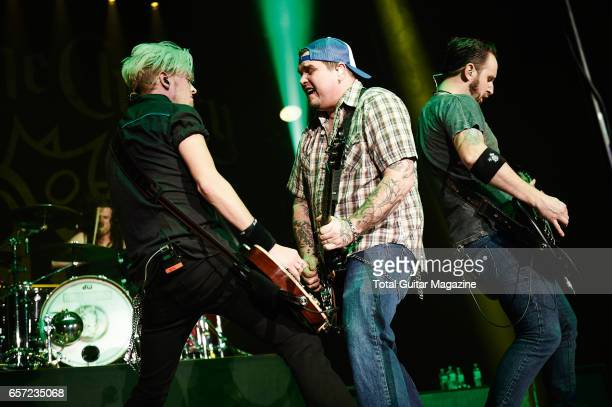 Ben Wells Chris Robertson and Jon Lawhon of American hard rock group Black Stone Cherry performing live on stage at the Motorpoint Arena in...