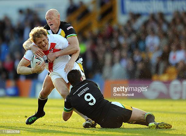 Ben Westwood of England is tackled by Craig Fitzgibbon and Danny Buderus of Exiles during the International Origin match between England and Exiles...