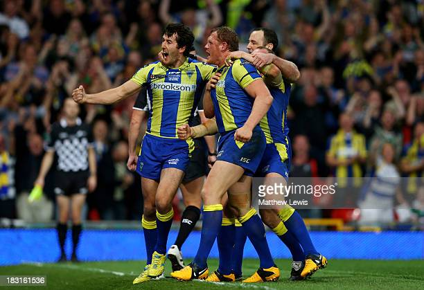 Ben Westwood of Warrington celebrates with teammates after scoring his team's third try during the Super League Grand Final between Warrington Wolves...