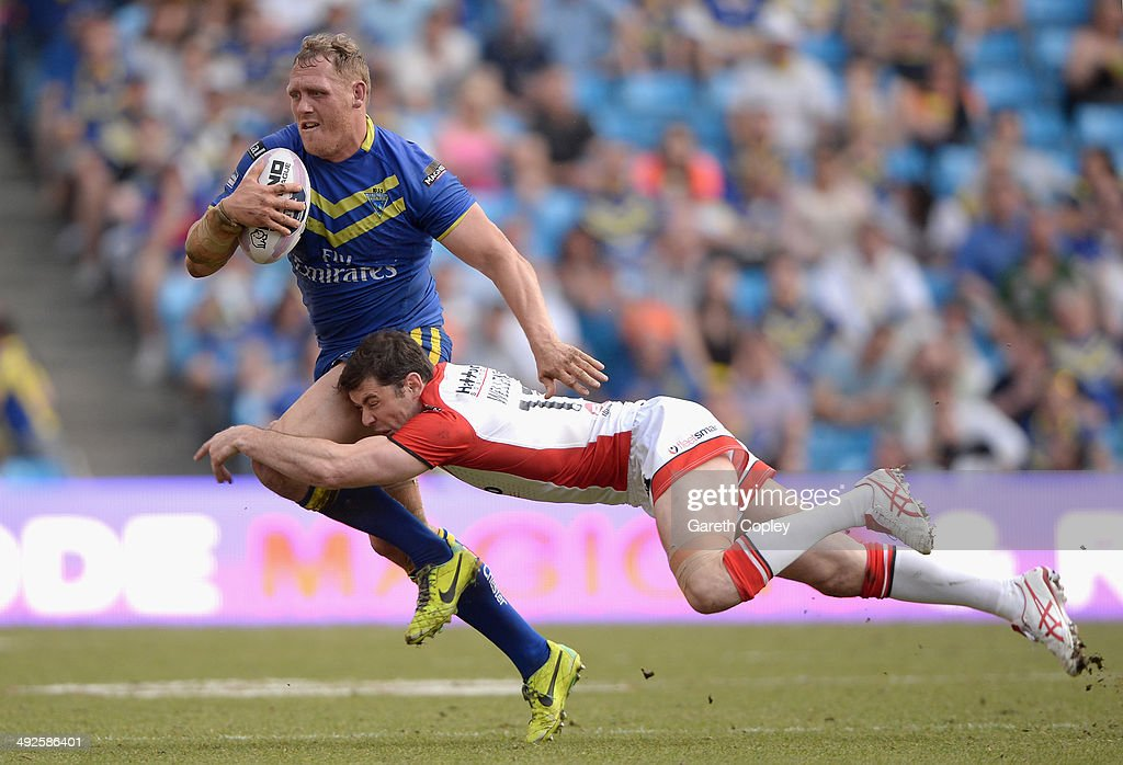 Ben Westwood of Warrington Wolves is tackled by Paul Wellens of St Helens during the Super League match between Warrington Wolves and St Helens at Etihad Stadium on May 18, 2014 in Manchester, England.