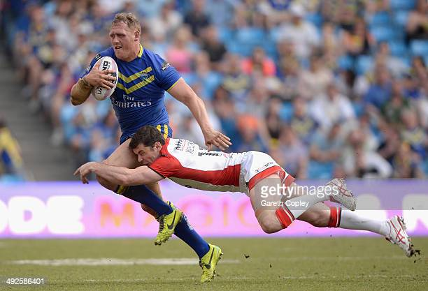 Ben Westwood of Warrington Wolves is tackled by Paul Wellens of St Helens during the Super League match between Warrington Wolves and St Helens at...