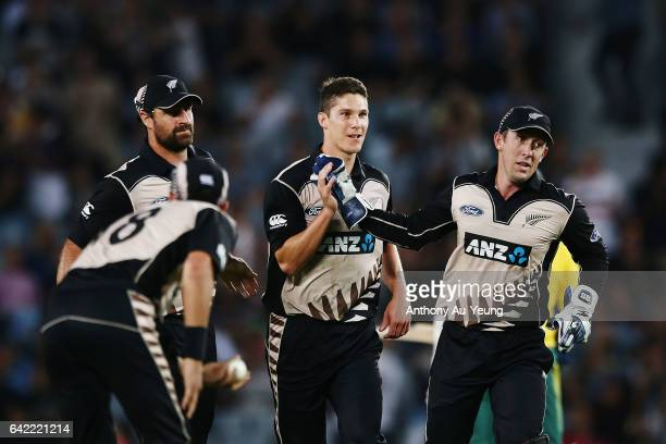 Ben Wheeler of New Zealand celebrates with teammate Luke Ronchi for the wicket of Hashim Amla of South Africa during the first International Twenty20...