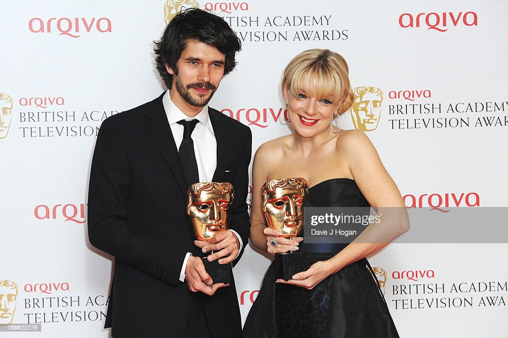 Ben Whishaw and Sheridan Smith pose with their Best Actor and Actress Awards in front of the winners boards at the BAFTA TV Awards 2013 at The Royal Festival Hall on May 12, 2013 in London, England.