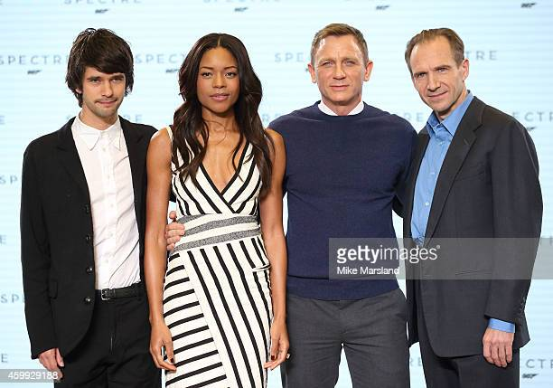 Ben Whishaw Naomie Harris Daniel Craig and Ralph Fiennes attend a photocall for the new James Bond film Spectre at Pinewood Studios on December 4...