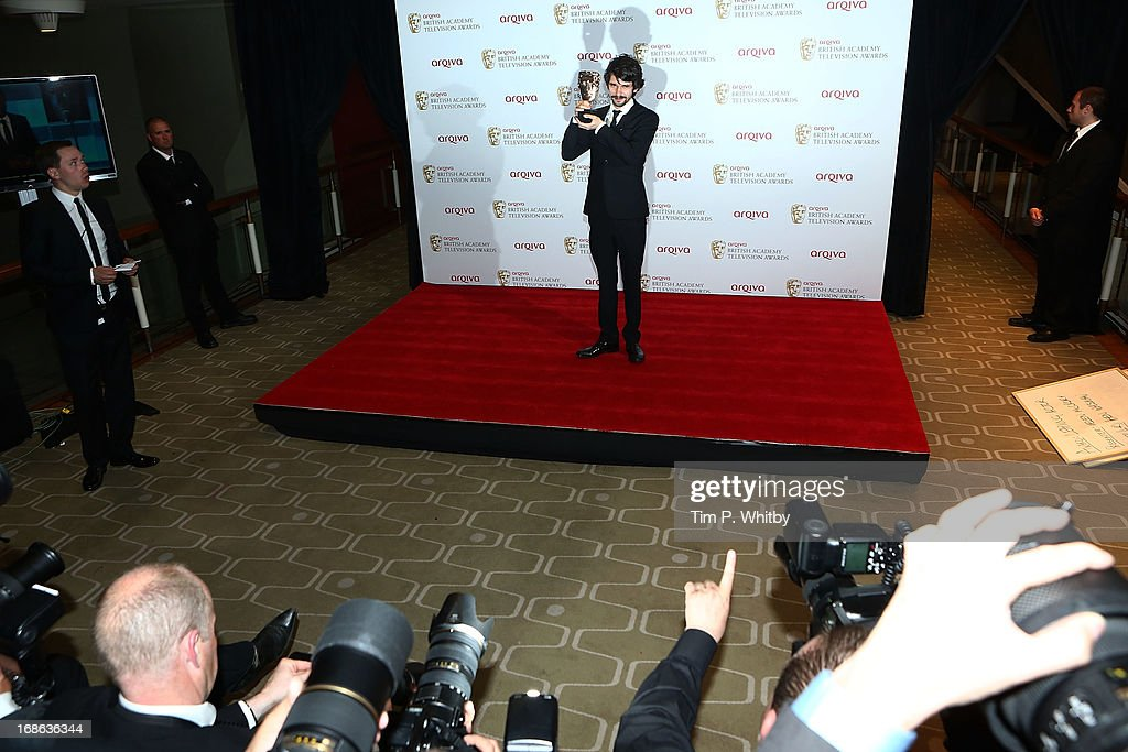 Ben Whishaw poses in the press room with his award for Best Leading Actor at the Arqiva British Academy Television Awards 2013 at the Royal Festival Hall on May 12, 2013 in London, England.