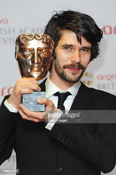 Ben Whishaw poses with his Best Actor Award in front of the winners boards at the BAFTA TV Awards 2013 at The Royal Festival Hall on May 12 2013 in...