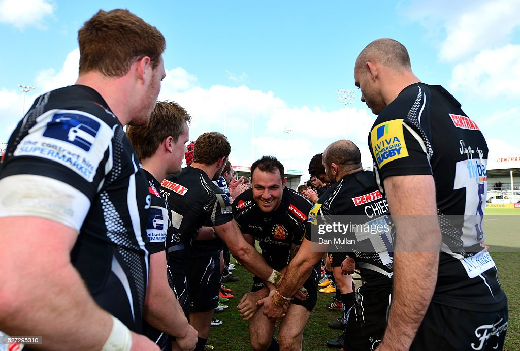 Ben White of Exeter Braves is congratulated by his team mates following victory during the Aviva Premiership A League Final between Exeter Braves and Northampton Wanderers at Sandy Park on May 02, 2016 in Exeter, England.