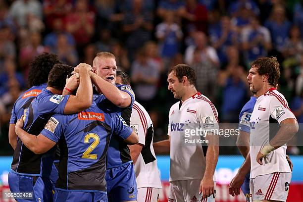 Ben Whittaker Heath Tessmann and Rory Walton of the Force celebrate winning the round 9 Super Rugby match between the Western Force and the Crusaders...