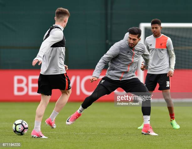 Ben Woodburn and Emre Can of Liverpool during a training session at Melwood Training Ground on April 21 2017 in Liverpool England