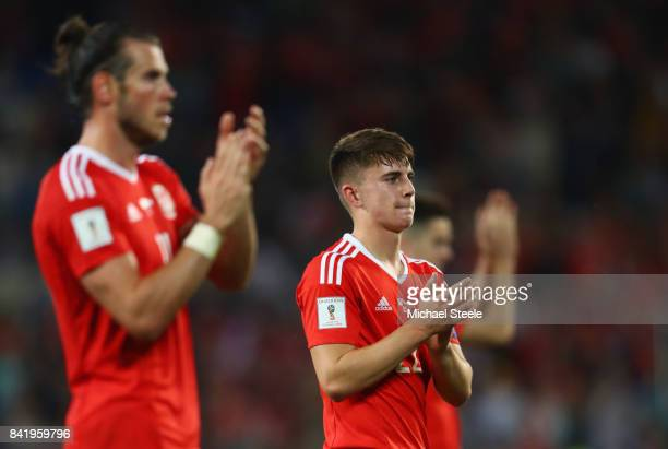 Ben Woodburn and Gareth Bale of Wales applaud the fans after victory in the FIFA 2018 World Cup Qualifier between Wales and Austria at Cardiff City...