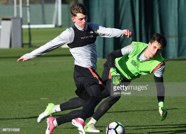 Ben Woodburn and Kamil Grabara of Liverpool during a training session at Melwood Training Ground on April 11 2017 in Liverpool England