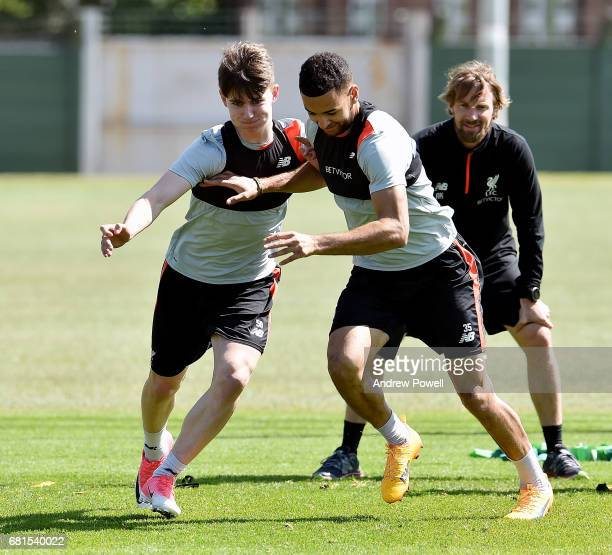 Ben Woodburn and Kevin Stewart of Liverpool during a training session at Melwood Training Ground on May 10 2017 in Liverpool England