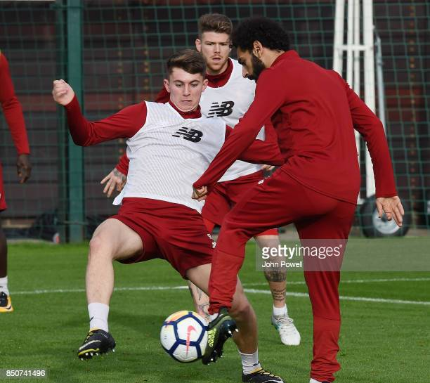 Ben Woodburn and Mohamed Salah of Liverpool during a training session at Melwood Training Ground on September 21 2017 in Liverpool United Kingdom