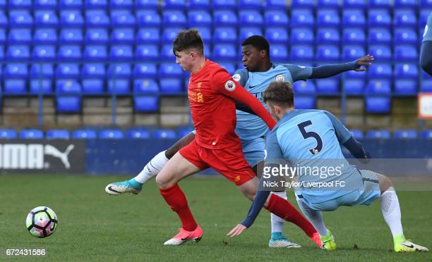 Ben Woodburn of Liverpool and Aaron Nemane and Will Patching of Manchester City in action during the Liverpool v Manchester City Premier League 2...