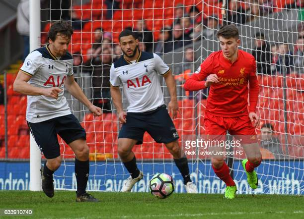 Ben Woodburn of Liverpool and Filip Lesniak and Cameron CarterVickers of Tottenham Hotspur in action during the Liverpool v Tottenham Hotspur game at...