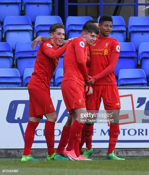 Ben Woodburn of Liverpool celebrates his first goal with team mates Harry Wilson and Rhian Brewster during the Liverpool v Manchester City Premier...