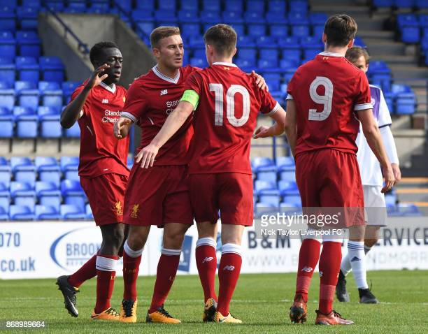 Ben Woodburn of Liverpool celebrates his goal with team mates Booby Adenakye Herbie Kane and Liam Millar during the Liverpool v Maribor UEFA Youth...