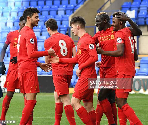 Ben Woodburn of Liverpool celebrates his goal with Tiago Ilori Matthew Virtue Mamadou Sakho and Madger Gomes during the Liverpool v Reading Premier...