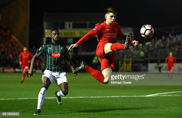 Ben Woodburn of Liverpool controls the ball during The Emirates FA Cup Third Round Replay match between Plymouth Argyle and Liverpool at Home Park on...