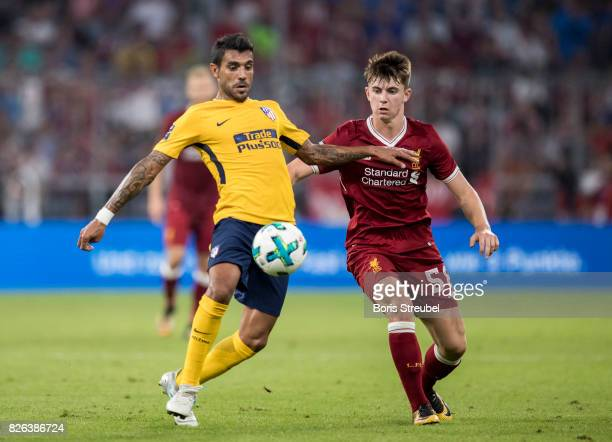 Ben Woodburn of Liverpool FC battles for the ball with Augusto Fernandez of Atletico Madrid during the Audi Cup 2017 match between Liverpool FC and...