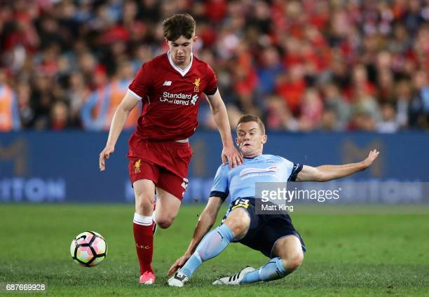 Ben Woodburn of Liverpool is challenged by Brandon O'Neill of Sydney FC during the International Friendly match between Sydney FC and Liverpool FC at...