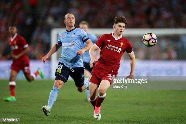 Ben Woodburn of Liverpool is challenged by Rhyan Grant of Sydney FC during the International Friendly match between Sydney FC and Liverpool FC at ANZ...