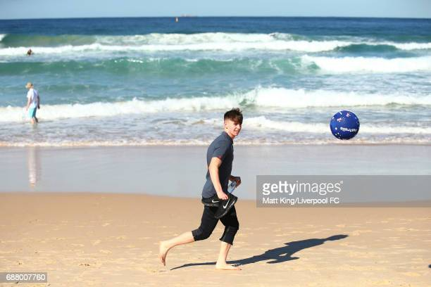 Ben Woodburn of Liverpool kicks a football during a Liverpool FC Fan Day at Bondi Beach on May 25 2017 in Sydney Australia