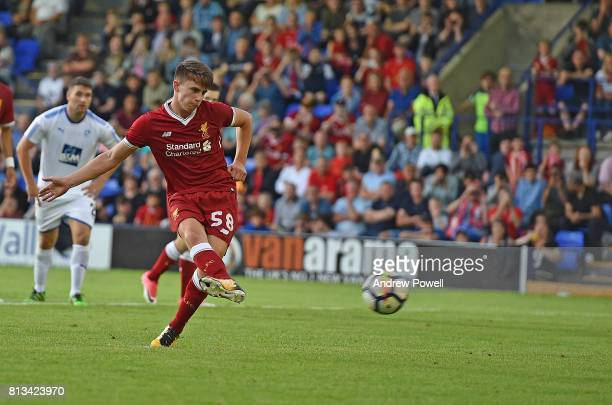 Ben Woodburn of Liverpool scores from the penalty spot during the pre season friendly between Tranmere Rovers and Liverpool at Prenton Park on July...
