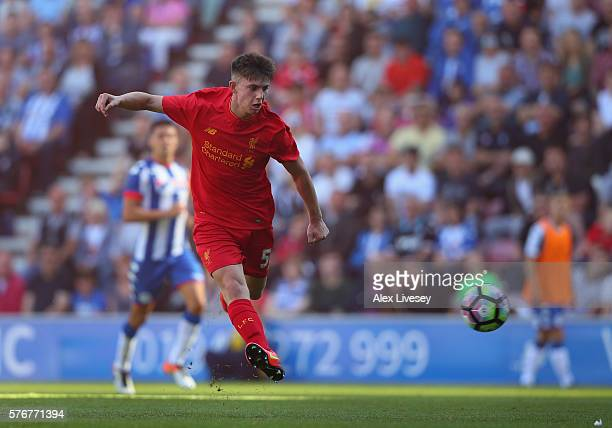 Ben Woodburn of Liverpool scores the second goal during a preseason friendly between Wigan Athletic and Liverpool at JJB Stadium on July 17 2016 in...