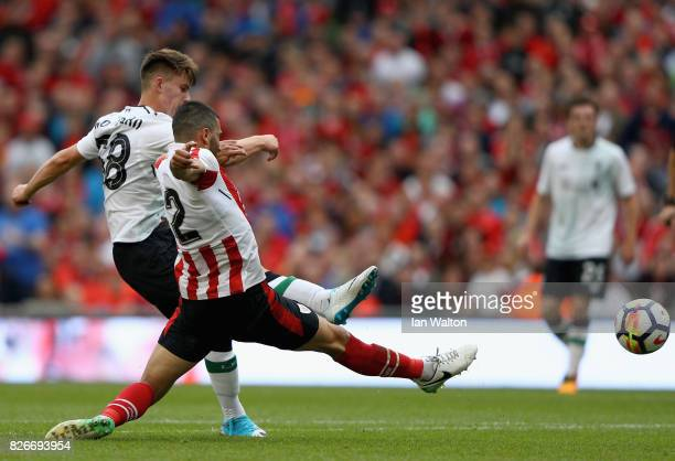 Ben Woodburn of Liverpool scores their teams second goal during the Pre Season Friendly match between Liverpool and Athletic Club at Aviva Stadium on...