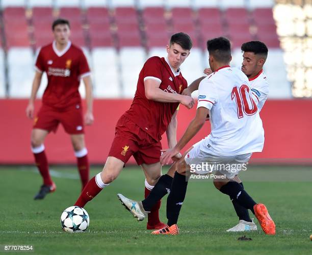 Ben Woodburn of Liverpool U19 competes with Charaf of Sevilla FC U19 during the UEFA Champions League group E match between Sevilla FC U19 and...